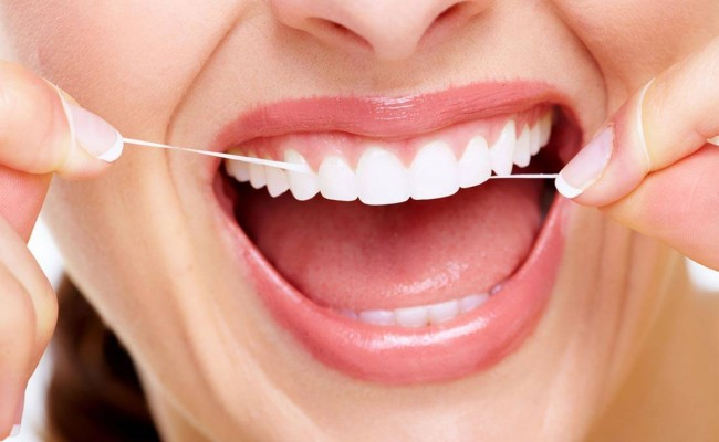 dentista-bellinzona-filo-interdentale-650x400
